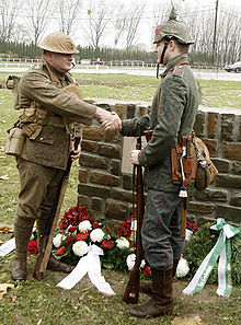 World War 1 Picture - Descendants of Great War veterans, in period uniforms, shake hands at the 2008 unveiling of a memorial to the truce.