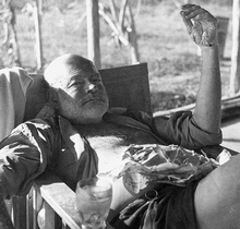 World War 1 Picture - Hemingway at a fishing camp. His hand and arms are burned from a recent brushfire; his hair burned from the recent plane crashes.