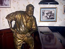 World War 1 Picture - Statue of Hemingway by Jos� Villa Soberx�n, El Floridita bar in Havana, with a photo of Hemingway awarding Fidel Castro a prize in a fishing contest in 1960 (after the Cuban revolution) on the wall.