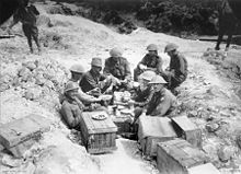 World War 1 Picture - Gellibrand and his staff having breakfast in a shell hole in Sausage Valley.