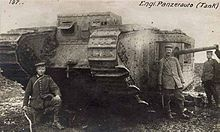 World War 1 Picture - German troops with British tank captured 11th April near Bullecourt