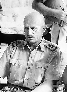 World War 1 Picture - Malaya. January 1942. Informal portrait of Major General Gordon Bennett, General Officer Commanding Australian Army Forces in Malaya, during a pause in his briefing of war correspondents (not seen)