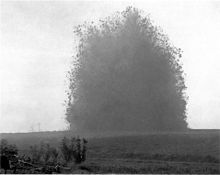 World War 1 Picture - Explosion of the Hawthorn Ridge mine, 7:20 am, 1 July 1916. A still from one of the earliest examples of combat photography to remain unedited. Photo by Ernest Brooks.
