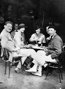 World War 1 Picture - Ernest Hemingway with Lady Duff Twysden, Hadley Hemingway, and three unidentified people at a cafe in Pamplona, Spain, July 1925