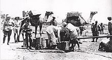 World War 1 Picture - Filling fantasies and loading them onto camels near Jaffa