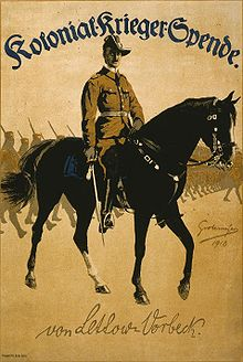 World War 1 Picture - World War I poster of German General Paul von Lettow-Vorbeck on horseback leading African soldiers. Text at top reads Colonial War Funds; on bottom is facsimile of von Lettow-Vorbeck's signature