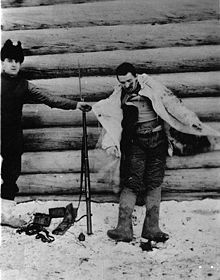 World War 1 Picture - A Bolshevik soldier shot by an American guard at Outpost No. 1 at 3:00 a.m. on the morning of Jan. 8, 1919 when an enemy patrol of 7 men attempted to creep up on the outpost position. This picture was taken to show the white cloak, which all the members of the patrol wore to conceal their movements in the snow. The clothing worn by the man was warm and in good condition. He carried, in addition to a hand grenade, which lies on the ground, a Remington rifle, in good condition, and a plentiful supply of ammunition. Village of Visorka Gora, Russia. Jan. 8, 1919. (from the U.S. Army Signal Corps official photo caption).