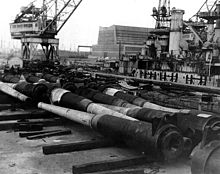World War 1 Picture - Guns from battleships being scrapped in Philadelphia Navy Yard in December 1923. USS South Carolina being dismantled in the background.