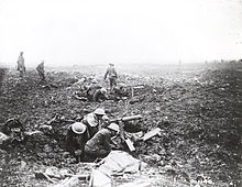 World War 1 Picture - Machine gunners operating from craters on the plateau above the ridge