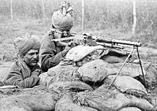 World War 1 Picture - A Benet-Mercier machine gun section of 2nd Rajput Light Infantry of British Indian Army in action in Flanders, during the winter of 1914-15.