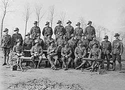 World War 1 Picture - Group portrait of the officers and NCOs of the 24th Machine Gun Company in March 1918. Sergeant Cedric Popkin is second from the right in the middle row.