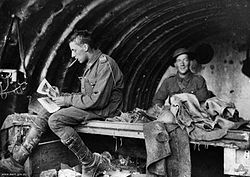 World War 1 Picture - Gunners Baker and Harrison of the 16th Battery relax in a dugout c. 1916