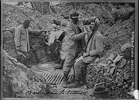 World War 1 Picture - A barber in a French trench