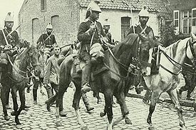 World War 1 Picture - French cavalry marching German prisoners
