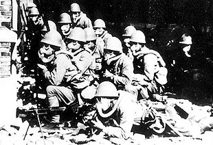 World War 1 Picture - Imperial Japanese soldiers wearing gas masks and rubber gloves during a chemical attack in the Battle of Shanghai.