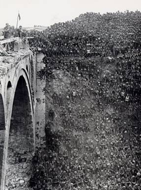 World War 1 Picture - Brigadier General J V Campbell addressing troops of the 137th Brigade (46th Division) from the Riqueval Bridge over the St Quentin Canal