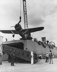 World War 1 Picture - VMF-211 F2A-3 being shipped to Midway, in early 1942.