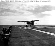 Airplane Picture - USMC OY-2 takes off from the USS Sicily, 1950.
