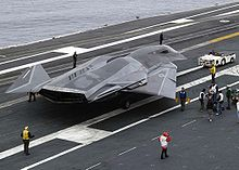 Airplane Picture - F/A-37 Talon mockup on the flight deck of the USS Abraham Lincoln, CVN-72 commissioned 1989