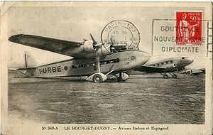 Airplane Picture - Paris-Le Bourget Airport in 1935. I-URBE (in the foreground) is an S.74; the other aircraft is a Douglas DC-2 airliner operated by the Spanish airline LAPE (Lineas A�reas Postales Espax�olas).