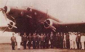 Airplane Picture - Japanese officials pose with the SM.75 GA RT and its crew during its July 1942 visit to East Asia.