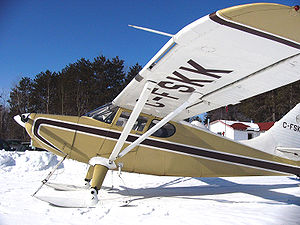 Airplane Picture - A Canadian 1949 model Stinson 108-3 on skis. The partial span leading edge slot is visible