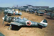 Warbird Picture - Ki-84s and Ki-43s photographed on a JAAF base in Korea post-war. The Ki-84 in the foreground is from the 85th Hiko-Sentai, the next one in line belonged to the 22nd Hiko-Sentai HQ Chutai
