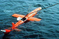 Airplane Picture - MQM-74C Chukar II floating and being recovered.