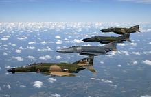 Airplane Picture - A formation of F-4 Phantom IIs fly during a heritage flight demonstration to commemorate the 50th Anniversary of the U.S. Air Force.