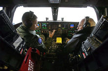 Airplane Picture - Vice President Dick Cheney sits inside the cockpit of a B-2 with pilot Capt. Luke Jayne during a visit to Whiteman AFB in 2006.