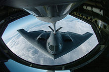 Airplane Picture - A B-2 during aerial refueling which extends its range past 6,000 miles to support intercontinental sorties.