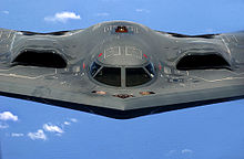 Airplane Picture - The B-2's engines are buried within its wing to conceal the induction fans and minimize their exhaust signature. The crew of two sit side-by-side in the cockpit.
