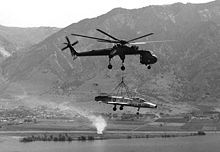 Airplane Picture - A CH-54 Tarhe lifting an F-100A to Hill Air Force Base, Utah for static display, 1979