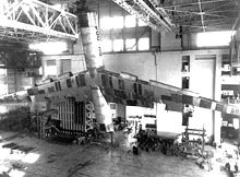 Airplane Picture - An B-36 airframe undergoing structural stability tests. Note for scale the three men at the extreme right of the photograph
