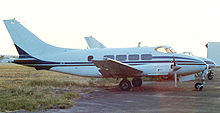 Airplane Picture - Riley Dove with Lycoming engines and taller swept fin at Long Beach airport in April 1987
