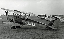 Airplane Picture - Tiger Moth Coupe with spatted undercarriage at Coventry Airport in 1955
