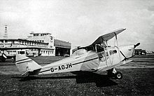 Airplane Picture - Canadian-built DH.83C Fox Moth with canopy fitted to pilot's position at Manchester (Ringway) Airport in 1955