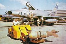 Airplane Picture - An F-100D of the 308th TFS, being loaded with Mk 117 750 lb bombs at Tuy Hoa, South Vietnam, in early 1966.