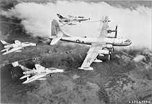 Airplane Picture - A USAF KB-50D of the 622d Air Refueling Squadron carrying out the first triple-point refuelling operation with three F-100Cs in 1956