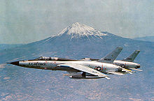 Airplane Picture - Two U.S. Air Force Republic F-105 Thunderchiefs, an F-105F-1-RE trainer and an F-105D-31-RE, with Mount Fuji, in the background.