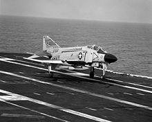 Airplane Picture - A U.S. Navy F-4J Phantom II BuNo 153769 of VF-31 lands on the USS Saratoga.