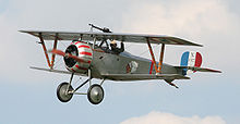 Airplane Picture - A Nieuport 17 in flight at a display in 2007. Insignia is of the Lafayette Escadrille. Note that this is a scaled-down replica, and not a full size aircraft.
