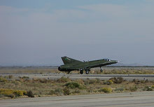 Airplane Picture - Ex-RDAF RF-35XD N217FR operated by the National Test Pilot School takes off from the Mojave Spaceport.