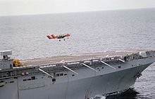 Airplane Picture - An OV-10A Bronco from VMO-1 takes off from the flight deck of the USSNassau(LHA-4) in 1983