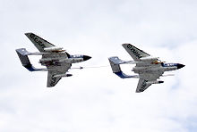 Airplane Picture - Two Sea Vixen FAW.1 aircraft (XJ571 & XN694) of 899 Sqn, one refuelling the other at a 1960s Farnborough Air Show