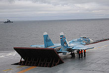 Airplane Picture - Su-33 being prepared for take-off on the Admiral Kuznetsov.