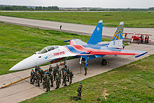 Airplane Picture - A Russian Knights Su-35 accompanied by Russian Airborne Troops.