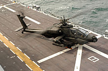 Airplane Picture - A US Army Apache aboard USS Nassau during Joint Shipboard Weapons and Ordnance training