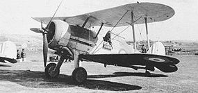 Airplane Picture - Faith (serial number N5520), a Gloster Sea Gladiator Mk I, on the ground at an airfield in Malta, in about September 1940. The aircraft has been refitted with a Bristol Mercury engine and three-bladed Hamilton propeller salvaged from a Bristol Blenheim.