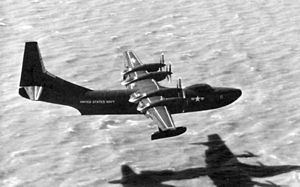 Warbird Picture - R3Y-1 Tradewind low over San Francisco Bay near NAS Alameda